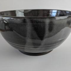 Sleek black and white pottery bowl