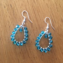 Teal green faceted glass teardrop earrings
