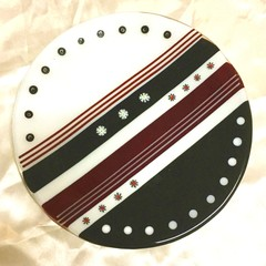 Black white and red plate