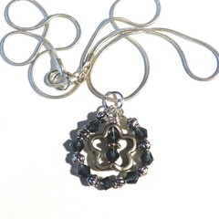 Necklace. Pendant. Silver and blue crystals. Silver charm and chain.