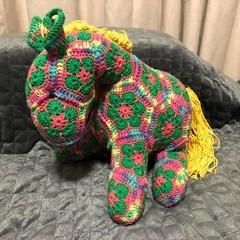 Crochet African horse green, pink variegated.