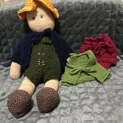 Knitted doll and clothing.