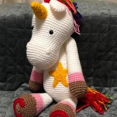 Crochet rainbow unicorn cuddly toy