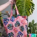 Peachy Pink and Rainbow monstera tote bag