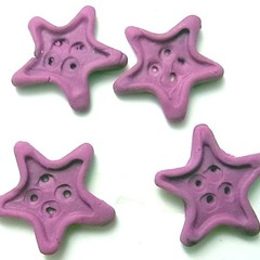 Buttons. Little purple star buttons. Set of four polymer clay buttons