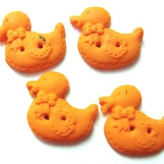 Buttons, handmade. Little orange ducks all in a row polymer clay buttons