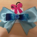 Large classic baby blue bow with embellishment.