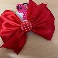 Large red satin pinwheel bow with embellishment