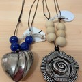 Necklace with pendant and beads.
