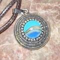 Small round antique silver pendant
