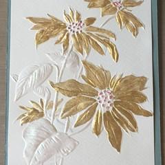 Golden poinsettia greeting card