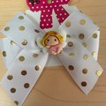 Double looped classic bow with clay embellishment