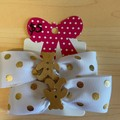 White and gold spotted bow clips with embellishment